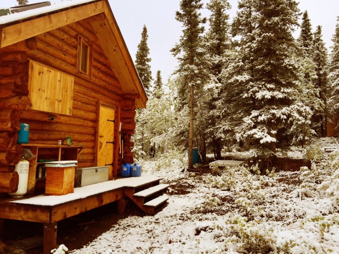 Photo of the Alaska cabin in snow