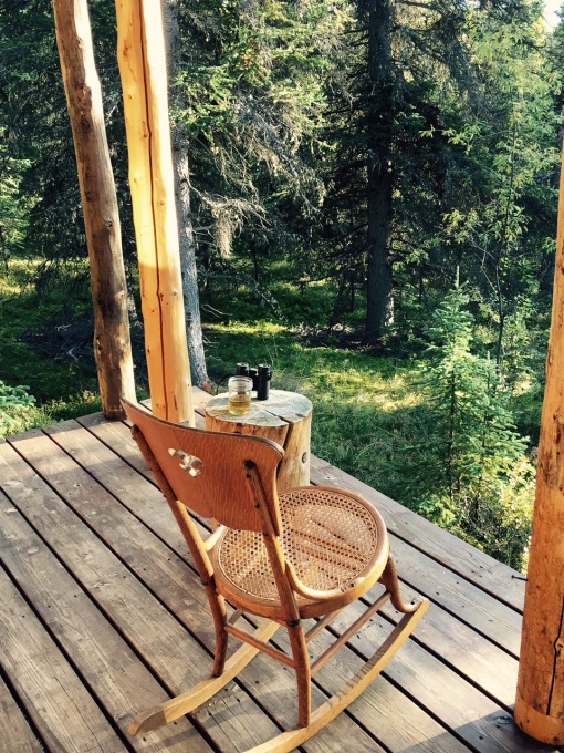 Photo of rocking chair, binoculars, and a glass of scotch