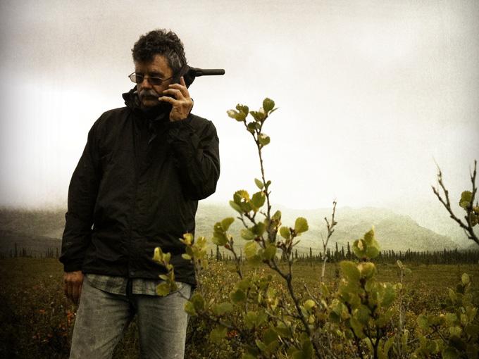 Talking on a satellite phone on the Alaskan tundra