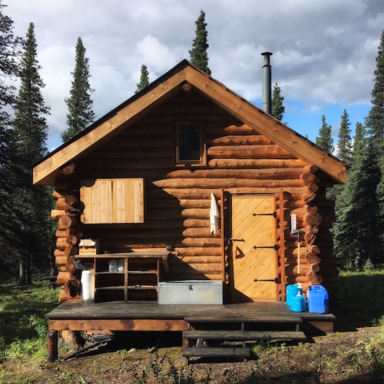 Photo of the back porch of our Alaskan log cabin